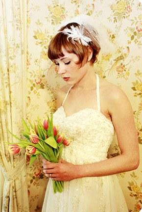 Tocados de novia con plumas tocado_plumas_6_290x432