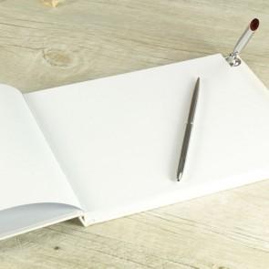 Libro de firmas blanco con bolígrafo