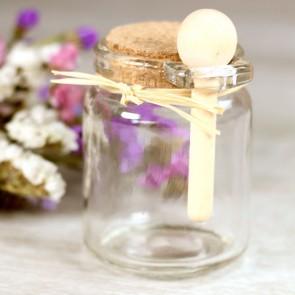 Botecito de cristal con cuchara de madera